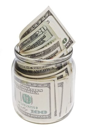 dollar banknotes in the glass jar photo