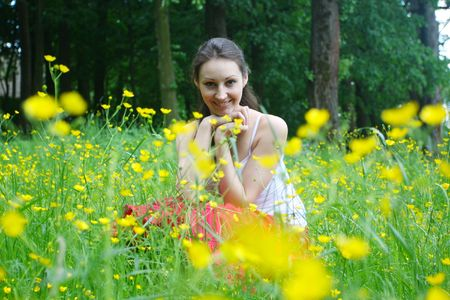 Girl relaxing on the meadow photo