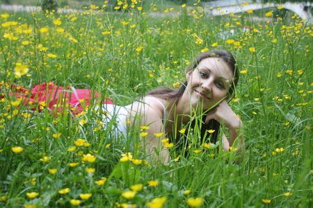 Girl relaxing on the meadow Stock Photo - 5004495