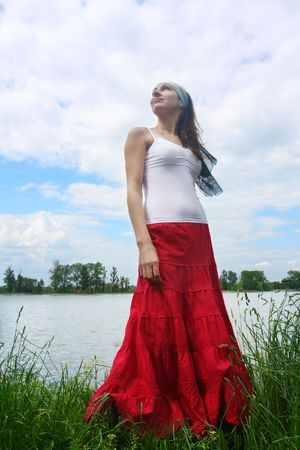 Woman near the lake on the meadow photo