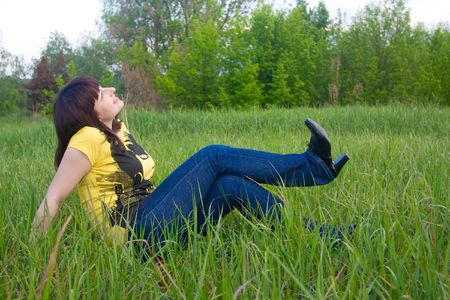 Girl relaxing on the meadow Stock Photo - 4974791