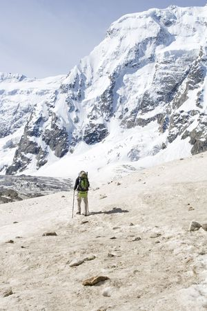 Hiker in Caucasus mountains photo
