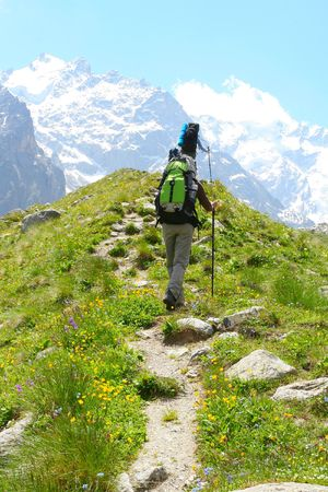 Hiker in Caucasus mountains Stock Photo - 5015440