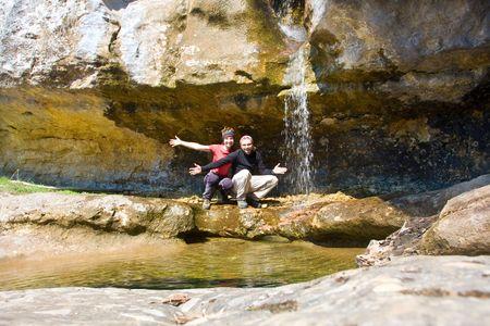 Couple near waterfall photo