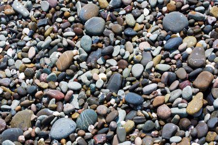 Stone on sea shore photo