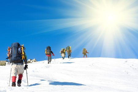 snow climbing: Hikers are in winter mountains