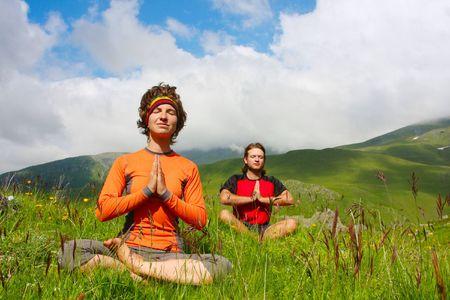 midlife: Man and woman practice yoga