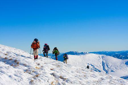 man climbing: Hiker in winter mountains