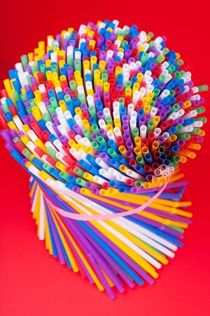 Colorful drinking straws background photo