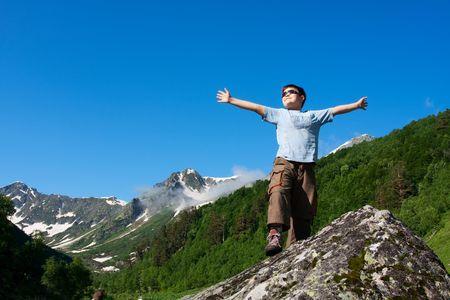 caucasus: Happy boy in Caucasus mountains Stock Photo
