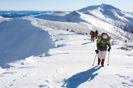 climbers: Hiker in winter in mountains Stock Photo