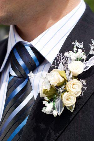 lapel: beautiful flowers on lapel of male