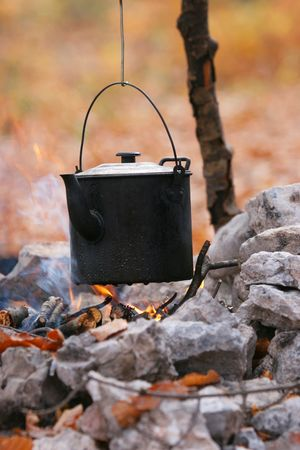 Teapot on the campfire photo