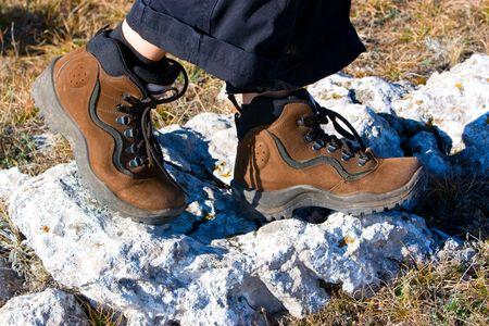 hiking boots at rocks photo