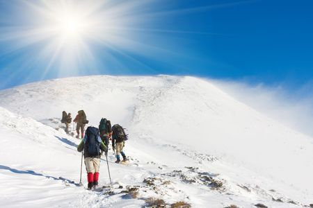 Hiker in winter in mountains Stock Photo