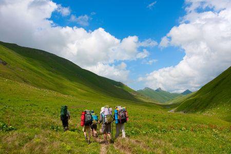Hiker in Caucasus mountains photo