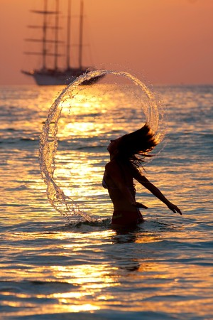 girl with long hair playing in the sea Stock Photo - 6907370