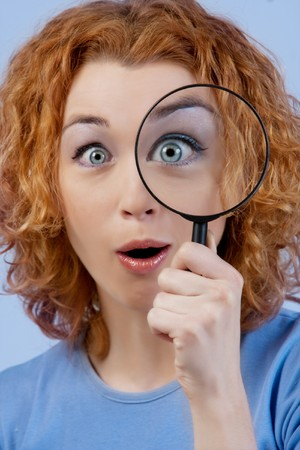 Eye and magnifying glass  photo