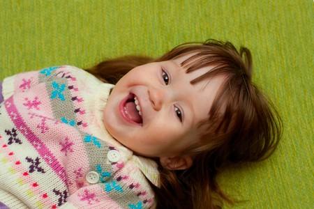 babygirl smiling at camera photo