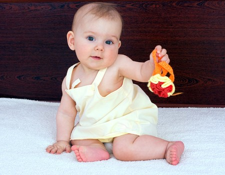 Baby is playing on bed photo