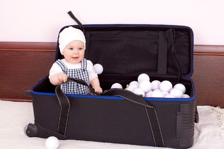 babygirl: Babygirl plays with balls in box