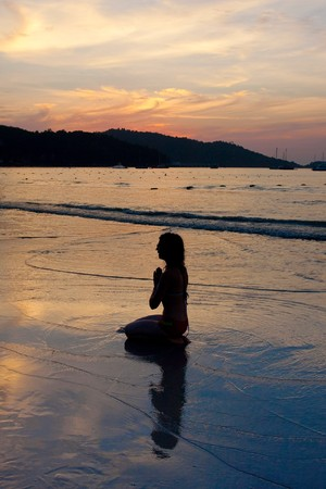 woman meditating by the sea Stock Photo - 7277245