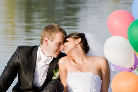 Happy bride and groom on their wedding day  photo