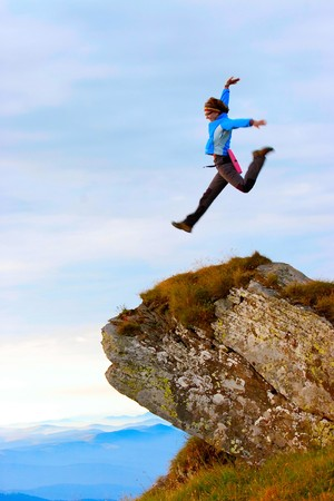 victory: Woman jump on the top Stock Photo