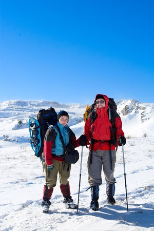 Hiker are in winter mountains photo