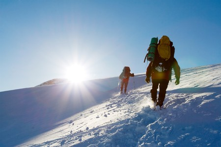 to climb: Hiker are in winter mountains