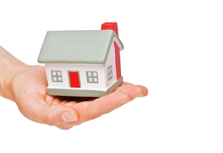 House symbol in hand Stock Photo - 8119118