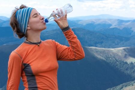 Hiker drinks photo