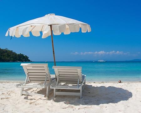deck chair: At the beach Stock Photo