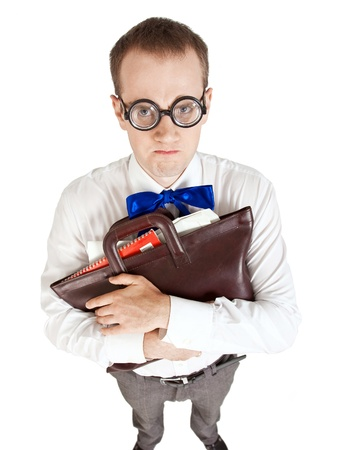 School nerd displeased and is looking into the camera isolated on white background with paper folder in hands photo