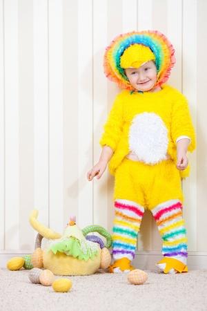 Child in costume of chicken  photo