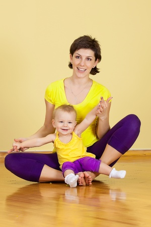 mother does fitness exercises together with her baby  Stock Photo - 9370685