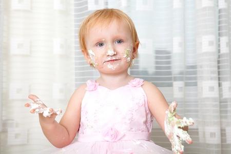 baby girl with cake  photo