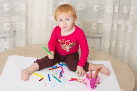 Kid drawing picture at home photo