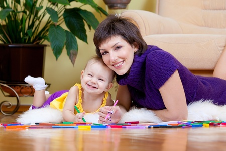 Mother and daughter drawing picture  photo