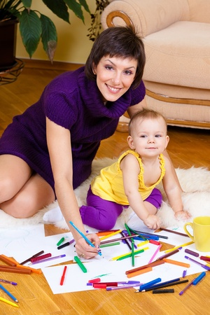 Mother and daughter drawing picture