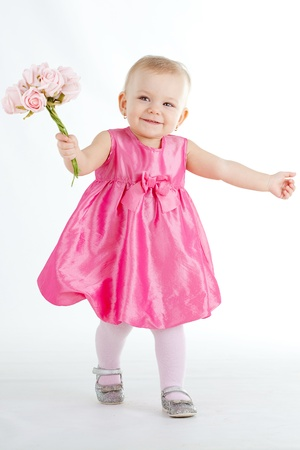 Happy baby girl at studio photo
