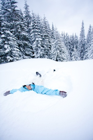 Hiker lying in snow  photo