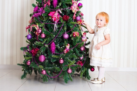 newyear: Kid near new-year tree