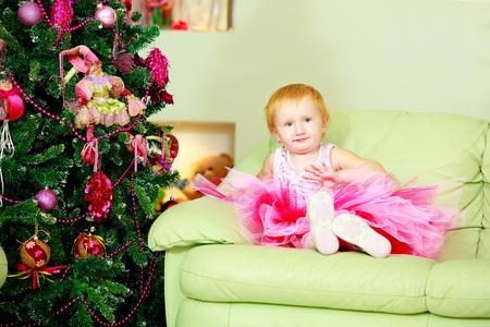 newyear: Kid near new-year tree