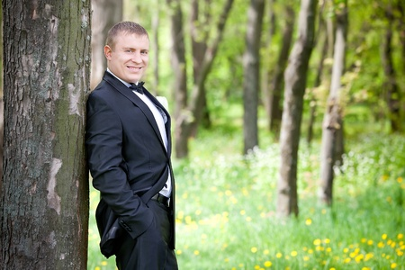 groom on a park at a wedding day  photo