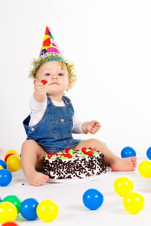 birthday food: baby girl with hat and cake