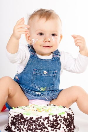 baby girl with hat and cake  photo
