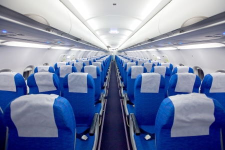 Cabin with empty chairs in the airplane photo