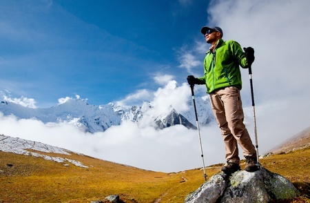 Hiker in Himalaya mountains  photo