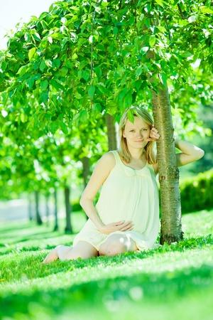 Pregnant female in park Stock Photo - 13578124